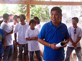 Church planter with believers at the new church in Tacloban